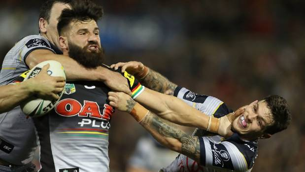 Penrith's Josh Mansour delivers a fend to the face of North Queensland's Kane Linnett.