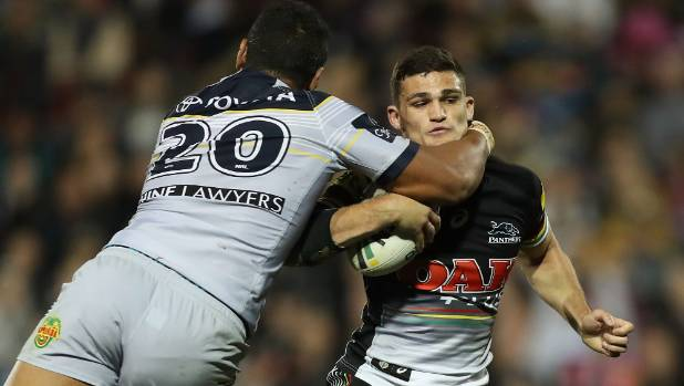 Penrith's Nathan Cleary cops a high tackle from North Queensland's Patrick Mago.