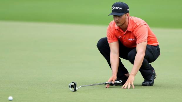 Chris Stroud of the United States lines up a putt on the 18th green during the second round of the PGA Championship at ...
