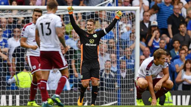 Burnley goalkeeper Thomas Heaton celebrates after their 3-2 victory over champions Chelsea.
