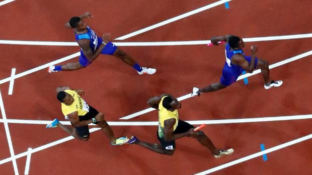 Baton change in the world 4x100 final with Jamaica's Yohan Blake passing it to Usain Bolt.