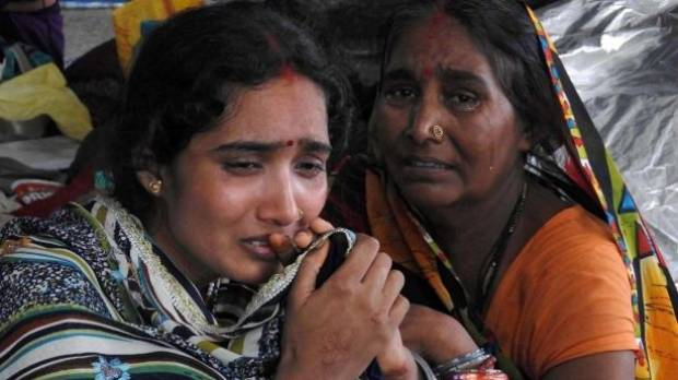 Relatives mourn the death of a child.