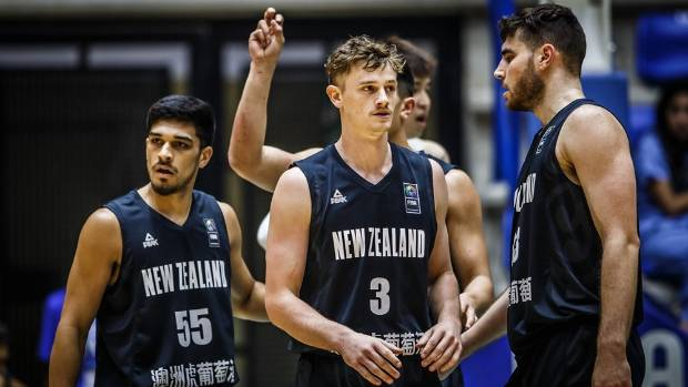 Finn Delany (centre), playing on his 22nd birthday, led the Tall Blacks' third-quarter comeback in the one-point loss to ...