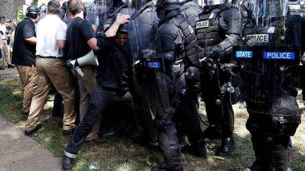 White supremacists scuffle with Virginia State Police after their rally was shut down.