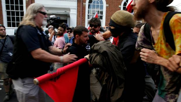 White supremacists clash with counter protesters during a rally in Charlottesville, Virginia.