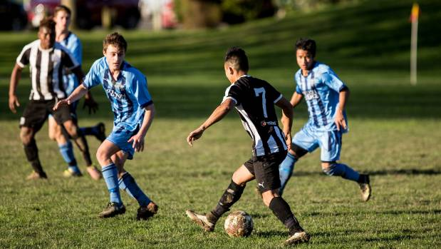 FC Nelson midfielder Labu Pan takes on the Nelson College defence.