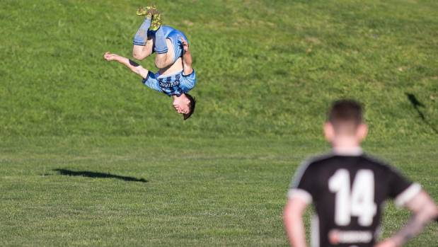 Nelson College striker Alex Connor-McClean celebrates with a somersault after scoring twice against FC Nelson.