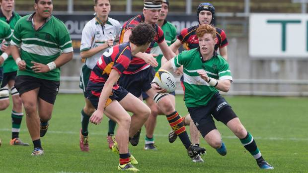 Opunake High School first five-eighth Luke Berquist tries to step through the Hawera High School defence during the ...