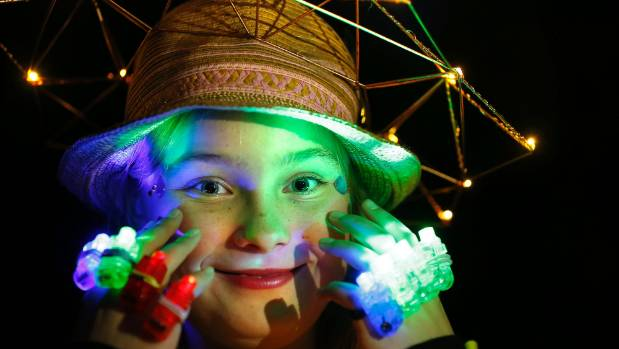 Alana Berry, 11, shows off her costume as part of the Totally Locally Wearable Lights Competition.