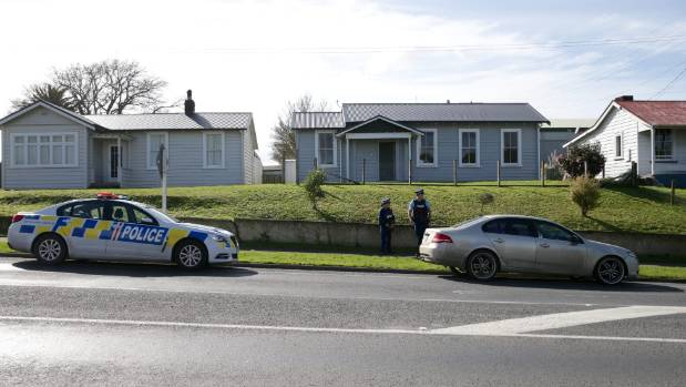 Armed police guarding a car in Studholme Street, Morrinsville. The car was removed by 11.40am.