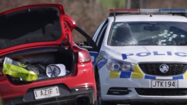 The red Holden Commodore abandoned after a shootout in Morrinsville. A cluster of bullet holes can be seen in the police ...