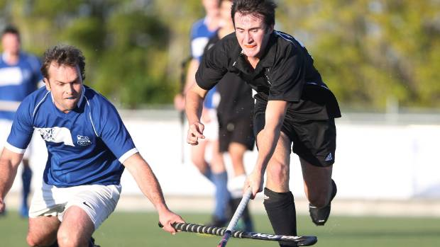 Andrew Brunton, of Cambridge, competes for possession of the ball against Liam Parker, of Temuka.