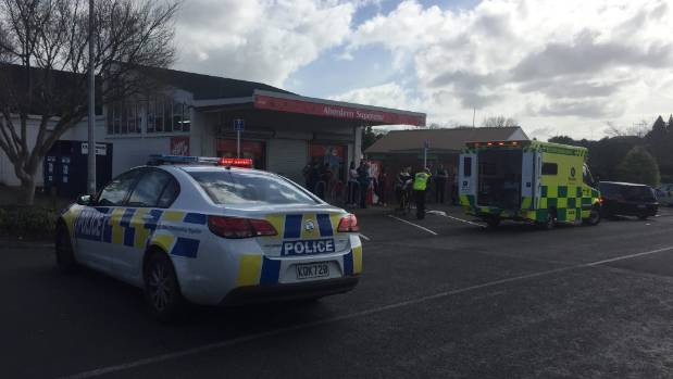 The Aberdeen Superette in Hamilton - the dairy owner was being loaded into the ambulance.