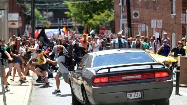A vehicle drives into a group of protesters demonstrating against a white nationalist rally in Charlottesville.