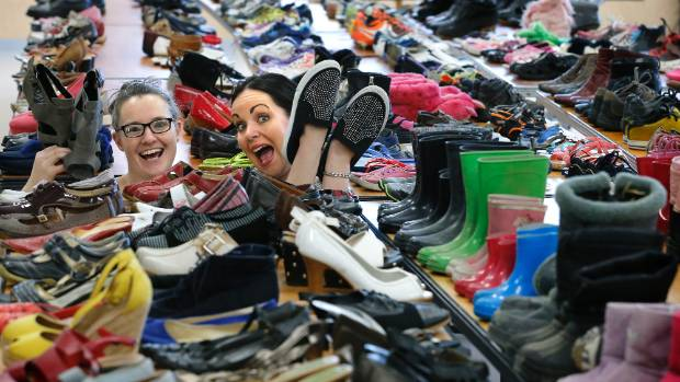 Sharelle Holdaway and Melanie McLean get to grips with hundreds of pairs of shoes at the Timaru Shoe Initiative.