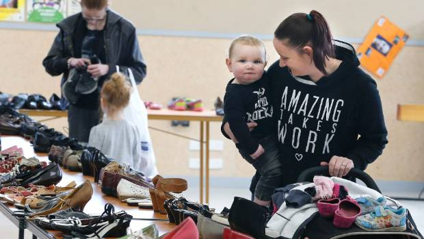 At the Shoe Initiative Bluestone School Hall were Grace Smythe and 1-year-old son Braxton Lord.