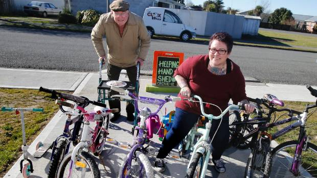Janine Philp launched the Helping Hands Shed at Temuka on Saturday. She's here with Nelson Bowden, who donated bikes to ...