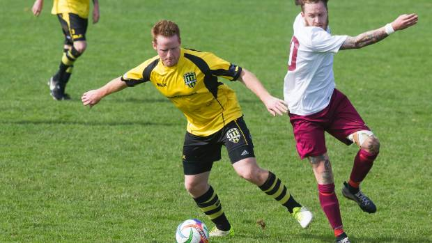 Team Taranaki's Wade Randle tries to escape the attention of Lower Hutt's Jared Cunnipp during their Central League ...
