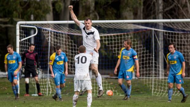 Ferrymead Bays centre-back Ciaran Aherne celebrates the first of his two headed goals in a 2-1 victory over Nelson Suburbs.