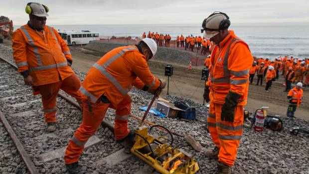 Members of the KiwiRail rebuild team complete a symbolic weld to represent the joining of the line between Picton and ...