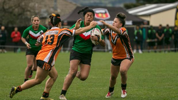 Papanui  defenders Vicki Logopati-Campbell and Kadison Robertson snuff out a Keas attack.