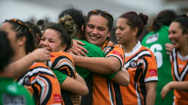 Delighted Papanui Tigers players acknowledge their Linwood Keas rivals after winning the Canterbury women's rugby league ...