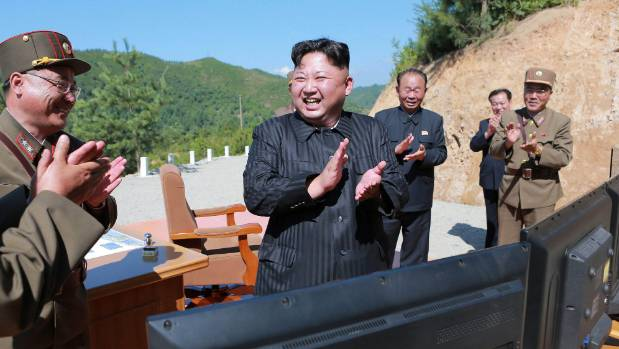 North Korea leader Kim Jong Un, centre, applauds after the launch of an intercontinental ballistic missile last month.