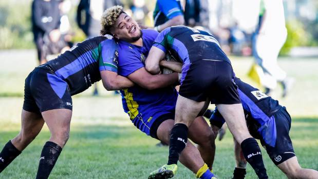 Randwick interchange player Starr Masae gets well and truly rounded up by the University Hunters, during Saturday's ...