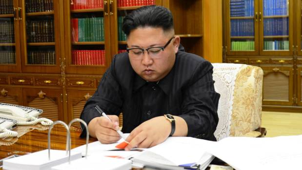 North Korean Leader Kim Jong Un signs the order to carry out the test-fire of inter-continental ballistic rocket Hwasong-14.