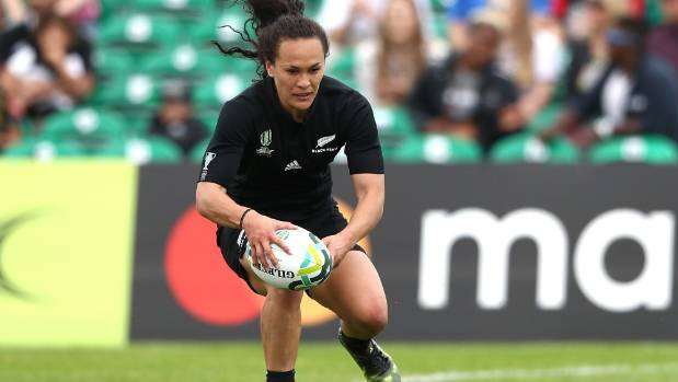Portia Woodman dots down for one of her eight tries in the 121-0 rout of Hong Kong.