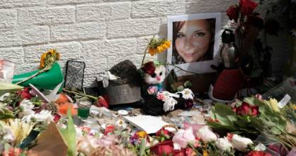 Flowers and a photo of car ramming victim Heather Heyer lie at a makeshift memoriall in Charlottesville, Virginia,  ...