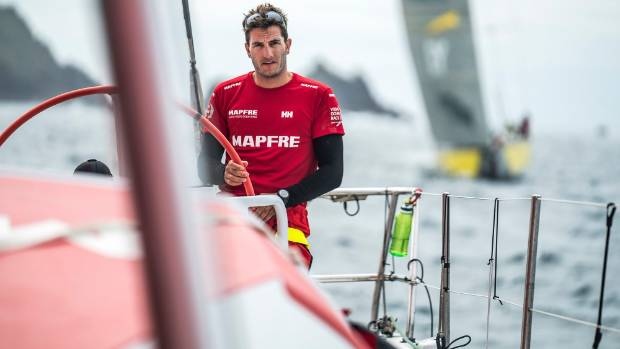 Blair Tuke at the wheel of Mapfre with Volvo Ocean Race rival Peter Burling's Team Brunel in his wake.