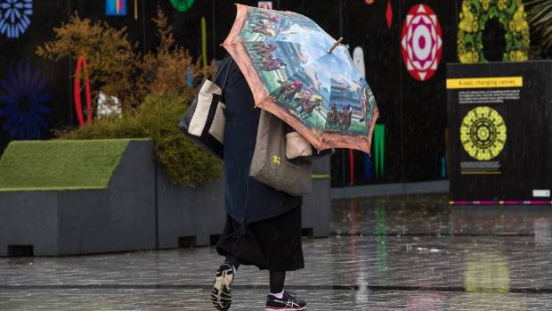 A pedestrian battles through a rainy Cathedral Square on Monday.