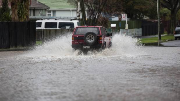 A 4WD is driven through flood waters in Christchurch.
