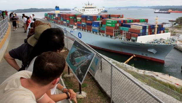 Visitors watching a container ship transit the Expanded Panama Canal at Agua Clara locks.