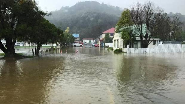 A street in Akaroa is flooded from heavy rain on Monday.