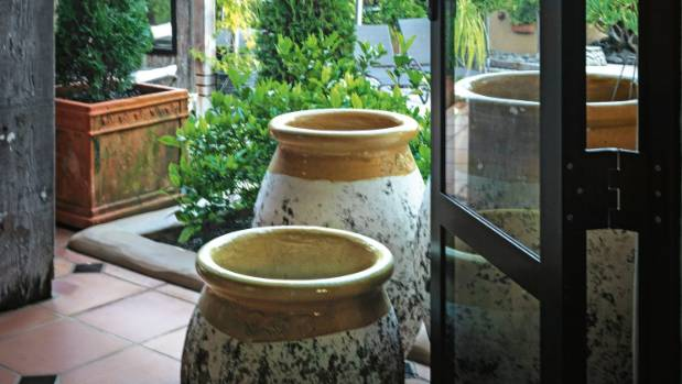 The large pots were bought at La Cigale French Market in Parnell, Auckland; Sue once caught a gardener trying to ...