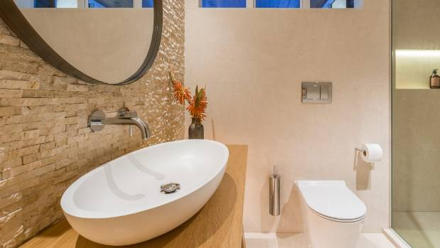 To provide a smooth surface for the installation of the fixtures  the  travertine was waterblasted. Supreme bathroom award celebrates contemporary design   Stuff co nz
