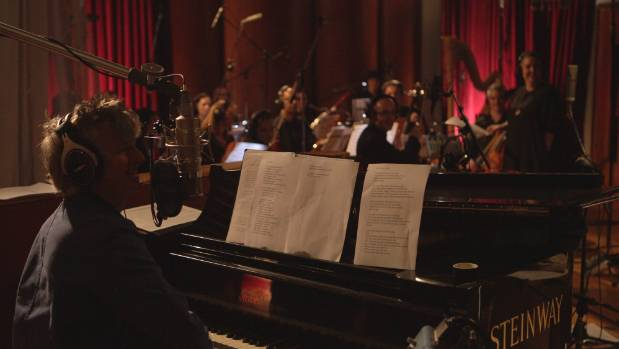 Finn and 20 piece orchestra with conductor, Victoria Kelly.