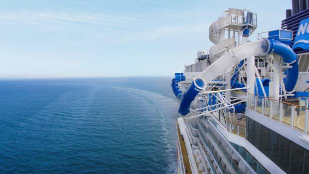 The high-speed Ocean Loops free fall slide includes two loops, one that extends out over the side of the ship and a ...