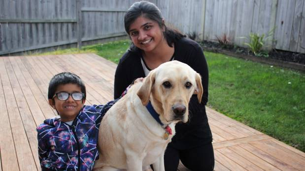 Sonia Kamdar is thankful for Leon the assistance dog who helps calm her son, Soham Rajasingam, who has autism.