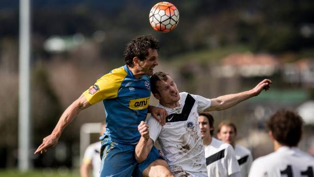 Nelson Suburbs striker Ben Wright challenges Ferrymead Bays defender Ciaran Aherne in the air.