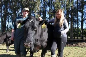 Logan and Melissa Johnson with their Farm Fresh South milking cows.