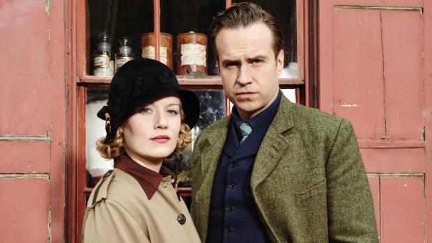 Rafe Spall as Harry Price and Cara Theobald as Sarah Grey.