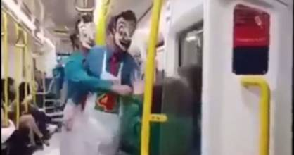 Video showed men masked and dressed in Mr Four Square costumes apparently attacking two teens on a train from Britomart ...