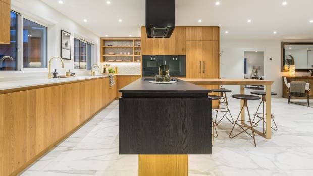 top auckland kitchen has a pared back design in natural and dark