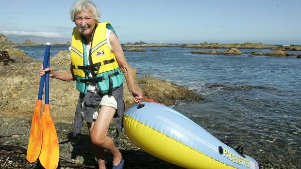 Sheila Natusch out for a paddle in her wee inflatable dingy in Owhiro Bay, Wellington.