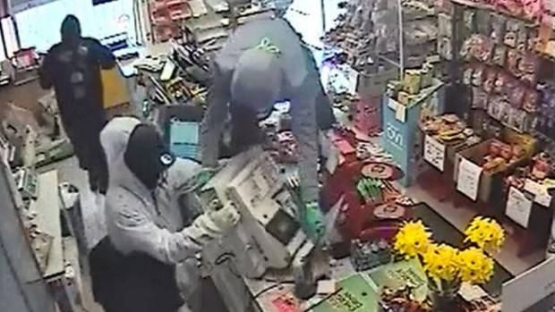 CCTV still of what police say was an aggravated robbery at Waitakere Township Superette, west Auckland, on August 16.