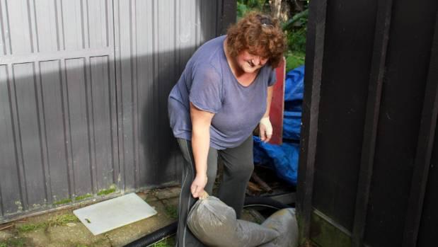 Julie Ingham has put sandbags around her Onetangi house to try to stop flooding.
