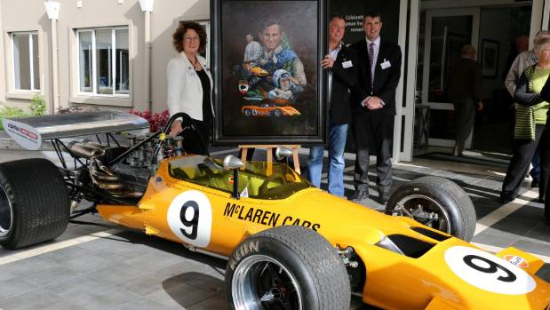 Jan McLaren, painter Craig Primrose and Ryman Healthcare's head of corporate affairs David King stand with the newly ...